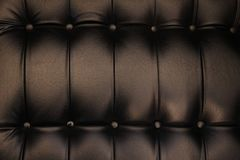 Black cushion background. In close up royalty free stock photography