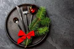 Black cutlery set, Christmas decoration on iron plate, slate background Stock Photo