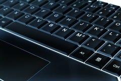 Black and cyan notebook keyboard Stock Photos