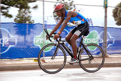 Black cyclist. Triathlete Thembanie Ngobo (South Africa) cycling his bike in the Ironman triathlon race in Port Elizabeth, South Africa, 13.04.2008 Royalty Free Stock Images