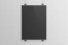 Black 3D illustration poster paper clip mockup with white frame. Black 3D illustration poster mock up with white frame on grey sandstone background. Paper clip Stock Image