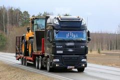 Black DAF XF Semi Truck Hauls Wheel Loader Royalty Free Stock Image