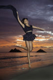 Black dancer on the beach at dawn Stock Photography