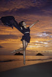 Black dancer on the beach at dawn Stock Image