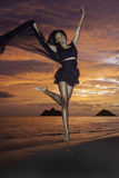 Black dancer on the beach at dawn Royalty Free Stock Image