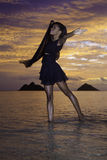 Black dancer on the beach at dawn Royalty Free Stock Photos