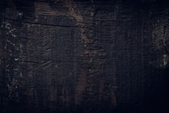 Black dark wood background, wooden board rough grain surface Royalty Free Stock Images