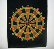 black dart board with bulls eye stock photography