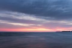 Black dawn-savage beach Stock Photos