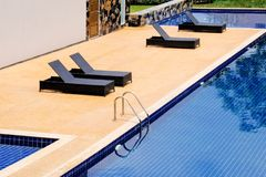 Black daybed at beside the swimming pool. Royalty Free Stock Image