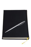 Black daybook and silver pen Royalty Free Stock Image
