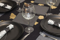 Black decoration napkin star shaped food table Royalty Free Stock Photo