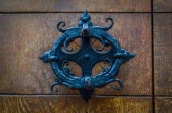 Black round door knocker. Black decorative door knocker on wooden door royalty free stock image