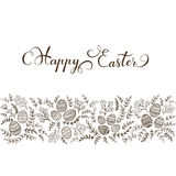 Black decorative eggs with floral elements and lettering Happy E Royalty Free Stock Photo