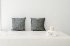 Black decorative pillows , candle and white towel Stock Photo
