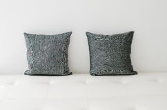 Black decorative pillows on a white casual sofa. In the living room Royalty Free Stock Images