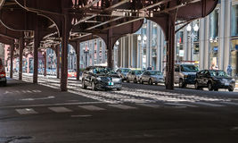 Black sedan drives under elevated tracks at Wabash and Adams, Ch Royalty Free Stock Photos