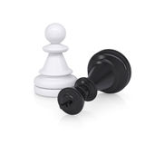 Black defeated chess king is near white pawns Stock Photo