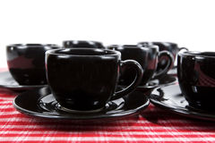 Black Demitasse Cups & Saucers Stock Photo