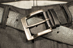 Black denim with belt buckle. Black denim with close up belt buckle Stock Image