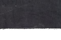 Black denim jeans torn leg close up. Close up of black denim jeans border frame over white background Stock Photo