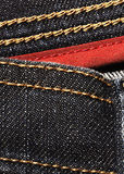 Black denim with red border Stock Photography