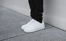Black denim and white sneakers Royalty Free Stock Images