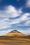 Black desert landscape with a nice sky background. Black desert landscape near bahariya oasis in Egypt Royalty Free Stock Image