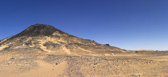 Black desert mountain, Oasis area, Egypt royalty free stock photo