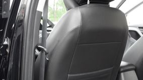 Design leather chair in car. stock video footage
