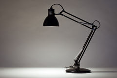 Black desk lamp  on white. Background Royalty Free Stock Images