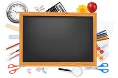 Black desk with school supplies. Stock Photo