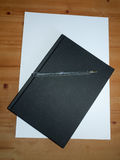 Black desktop notepad with ball point pen for taking notes for s. Tudying and students; Essex; UK stock photography