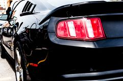 Black devil-muscle car. power... energy... adrenaline... drive royalty free stock photography