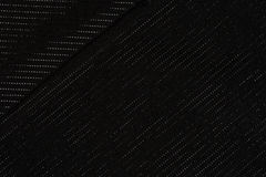 Black diagonal striped fabric, a background. Or texture Royalty Free Stock Photos