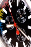 Black dial of chrono watch. Red hand on the black dial of chrono watch Royalty Free Stock Photography