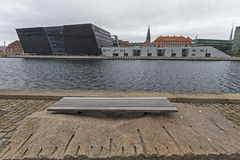 Black diamond of copenahagen. The Black Diamond (Danish: Den Sorte Diamant) is a modern waterfront extension to the Royal Danish Library's old building on Stock Images
