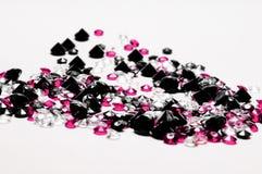 Black Diamonds. Black, pink and white Diamonds on white background Stock Photos