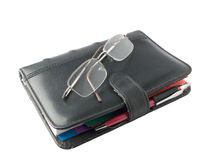 Black diary with glasses Royalty Free Stock Images