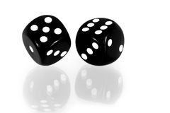 Black Dice Reflected. Black and white dice reflected on a white surface stock photos