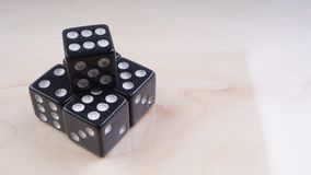 Black dice with white dots isolated on white background. Selective focus Stock Photography