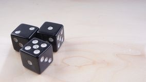 Black dice with white dots isolated on white background. Selective focus Stock Photo