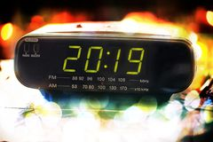Concept newyear 2019 from radio clock.happy new year and merry christmas 2019. Black digital alarm radio clock.Alarm radio clock indicating time to wake up royalty free stock images