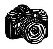 Black digital camera. Black digital SLR camera isolated on white background Royalty Free Stock Photos