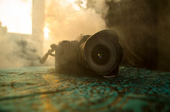 Black digital camera on dark background. Royalty Free Stock Photography