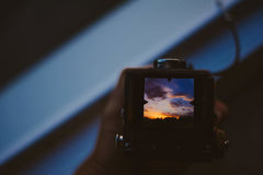 Black Digital Camera Showing Sunset Photo Stock Image