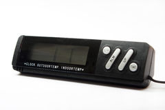 Black digital clock and a digital thermometer.  Stock Image