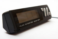 Black digital clock and a digital thermometer.  Stock Photography