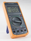 Black Digital Multimeter with orange bumper Stock Image
