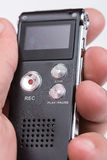 Black digital voice recorder in hand Royalty Free Stock Photography